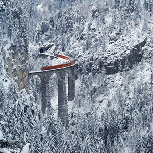 Train passing over the Landwasser viaduct in Graubnden, Switzerland
